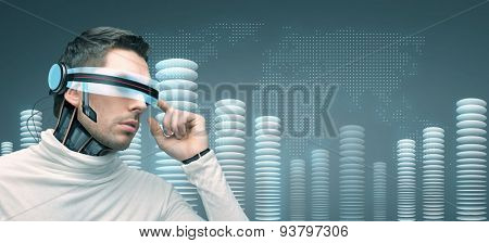 people, technology, future and progress - man with futuristic 3d glasses and microchip implant or sensors over blue background with world map and bit coin towers