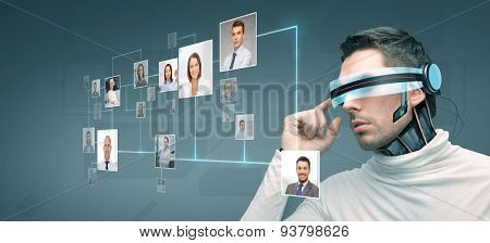 people, technology, future and progress - man with futuristic 3d glasses and microchip implant or sensors over blue background with network contacts icons