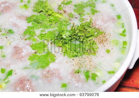 Bowl of Vietnamese rice porridge on the table in restaurant