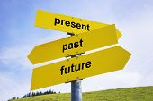 stock photo of past future  - Three yellow arrow signs with caption  - JPG