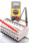 picture of  multimeter  - Electric switch on the control panel with multimeter - JPG