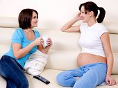 picture of pregnant woman  - The smiling pregnant woman communicates with the girlfriend  - JPG