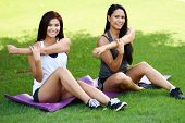 pic of boot  - Group of people doing a boot camp workout outside - JPG