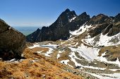 pic of rocky-mountains  - Picturesque view stretches over frozen lakes and high rocky mountain in valley of the Five Spis Ponds in Tatra mountains Slovakia - JPG