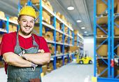stock photo of young men  - smiling caucasian young manual worker in warehouse - JPG