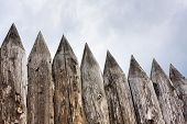 picture of hillbilly  - old wooden fence on the sky background - JPG