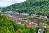 stock photo of old bridge  - Overview of Old Bridge Spanning Neckar River from New to Old Neighborhoods of Heidelberg - JPG