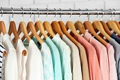 pic of clothes hanger  - Different clothes on hangers close up - JPG