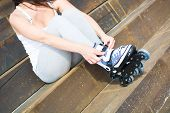 stock photo of roller-skating  - young woman with roller - JPG