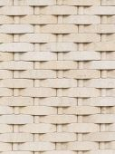 stock photo of cleaving  - wall of beige cast stone with a rough cleaved surface laid with wicker ornaments - JPG