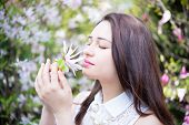 picture of magnolia  - beautiful dreamy girl holding a flower of magnolia - JPG