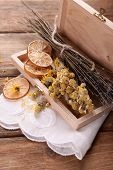 picture of roughage  - Different dried herbs and lemon on table close up - JPG
