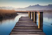foto of jetties  - Early morning at a jetty at lake Chiemsee - JPG