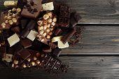 stock photo of hazelnut  - Set of chocolate with hazelnut on wooden table - JPG