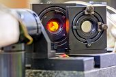 stock photo of laser beam  - Red laser on optical table in physics laboratory - JPG