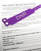 pic of resuscitation  - Do not resuscitate purple bracelet on top of a hospital medical form - JPG