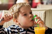 stock photo of orange-juice  - The boy has breakfast - JPG