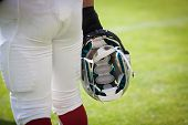 picture of football helmet  - american football player holding helmet - JPG