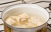 pic of boiling water  - the dumplings cooks in a pan with the boiling water - JPG