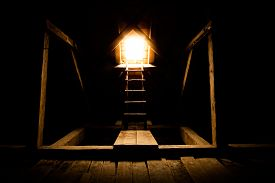 picture of roof-light  - Window in an old attic warm light is shining through a ladder leads into the light - JPG