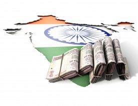 foto of indian flag  - The shape of the country of India in the colours of its national flag recessed into an isolated white surface with a wad of folded indian rupee notes resting on it - JPG