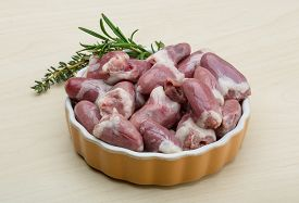 foto of giblets  - Raw chicken hearts with thyme and rosemary  - JPG