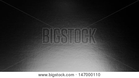 Abstract black background with spotlight paper texture
