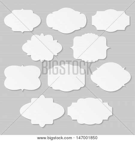 Set of white vintage labels and frames on gray background