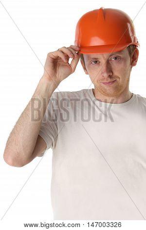 Studio portrait of a happy handyman in orange helmet
