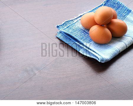 boiled eggs was placed on the blue tablecloth