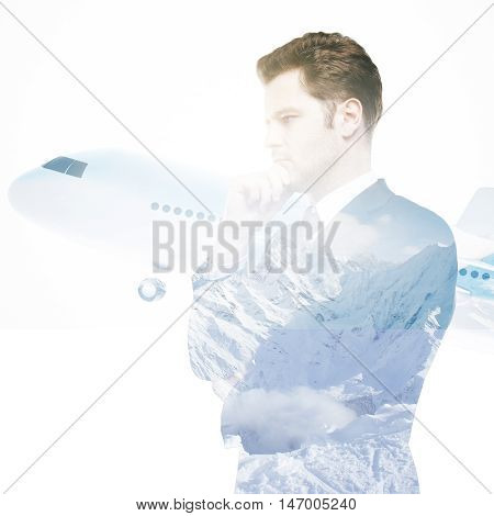 Side view of thoughtful young businessman and airplane on snowy landscape background. Double exposure