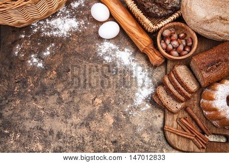 Fresh bread still life bakery product top view flour egg plunger on grunge textured background