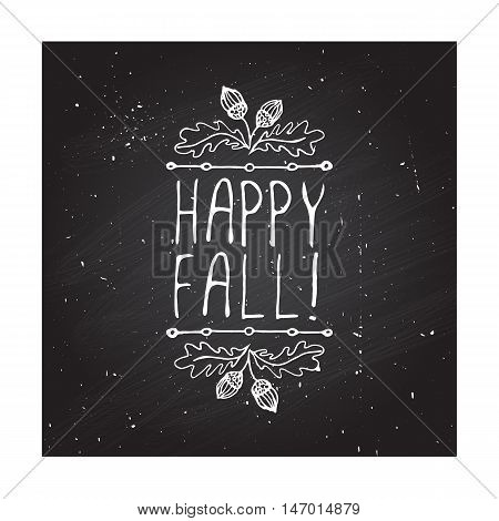 Hand-sketched typographic element with acorns and text on blackboard background. Happy Fall