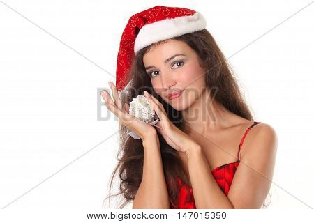 Beautiful Christmas woman in red santa hat holding Xmas decoration isolated on white