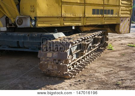 Closeup of the caterpillar track of a heavy construction machine.