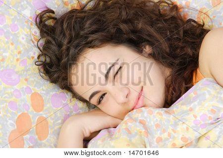 Beautiful teenage girl sleeping in the morning