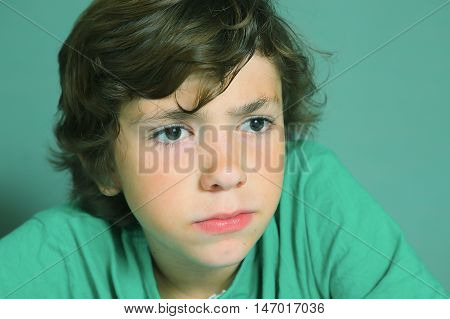 preteen handsome boy hard thinking close up portrait