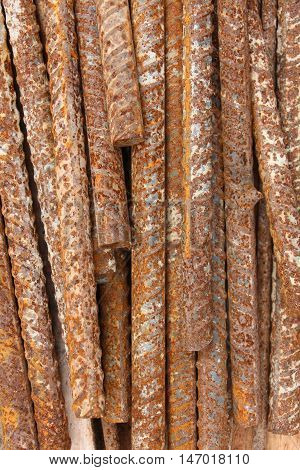 Stack of the metal rusty reinforcement bars.