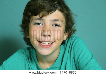 preteen handsome boy close up smiling portrait