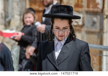 Orthodox Jewish Boy Walk In Jewish .quarter. Jerusalem. Israel