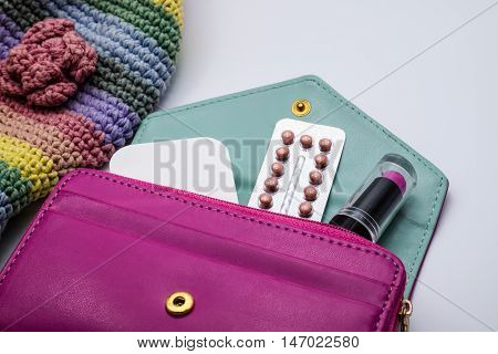 Blisters Of Birth Control  Pills In Pink Purse.