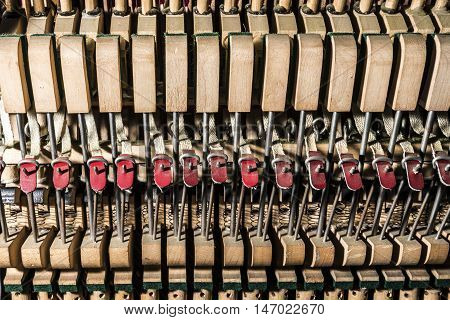 inside a piano, wooden parts, mechanisms closeup