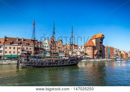 Gdansk old town and famous crane, Polish Zuraw. Motlawa river in Poland. The city also known as Danzig and the city of amber.