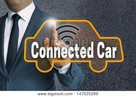 connected car touch screen is operated by businessman concept.