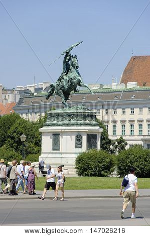 Vienna Austria - 04 July 2015 : Tourists walk in Hofburg under the monument of Archduke Charles - outstanding austrian military leader