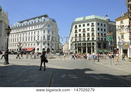 Vienna Austria - 04 July 2015 : Michaelerplatz is star-shaped square which connected Hofburg with four adjoining streets. In the middle of the square located the ruins of ancient roman fortifications. Due this fact Michaelerplatz considered to be historic