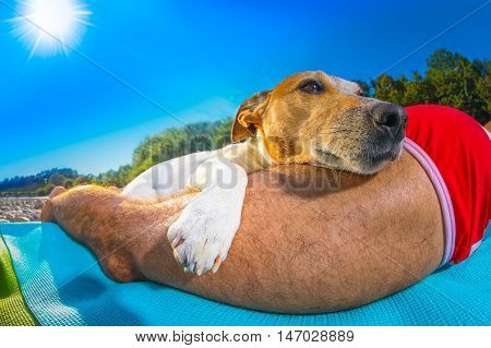 Dog And Owner Siesta At Beach