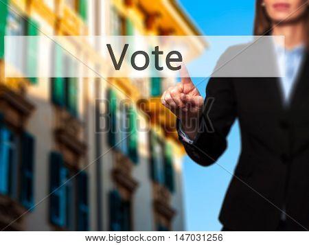 Vote - Businesswoman Pressing High Tech  Modern Button On A Virtual Background