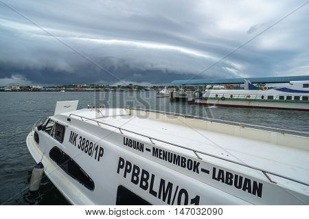 Labuan,Malaysia-Sept 12,2016:The shelf cloud storm moving over the Labuan,Malaysia on 12th Sep 2016.Shelf cloud are typically seen at the leading edge of a thunderstorm or squall line of thunderstorms