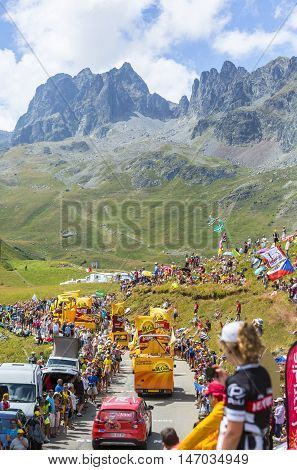 Col du Glandon France - July 23 2015: Mc Cain caravan during the passing of the Publicity Caravan on Col du Glandon in Alps during the stage 18 of Le Tour de France 2015. Mc Cain is a market leader in frozen products made from potatoes.